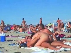 Naked swingers fucking like animals in the heat of the day on the wild beach