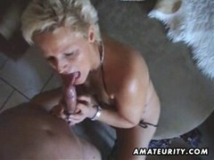 Short-haired mature blonde with natural tits plays with wher favorite toys before taking a dick in the mouth