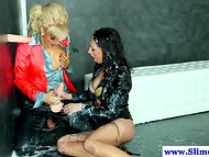 Two lesbians played with a dildo by the gloryhole, which exploded tons of white fluid