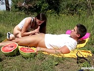 Before eating mellow watermelon teenage couple has quick sexual act on the lawn