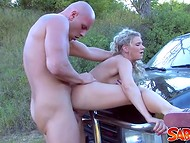 Strong guy fucked pretty coquette with huge boobies before they started the picnic