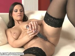 Attractive woman wears sexy stockings and masturbates so hot using her favorite dildo