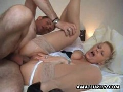 Blonde granny in stockings likes cock so much